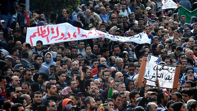 Egyptians chant slogans during a mass funeral in Port Said, Egypt,  on Jan. 27.