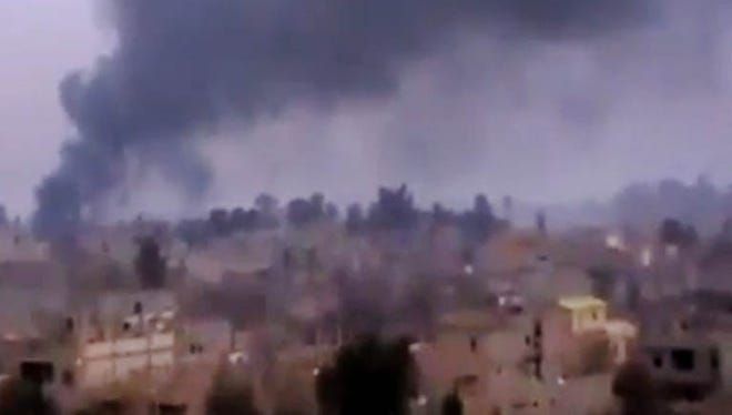 Smoke rises from heavy shelling in Deir el-Zour, Syria, on Jan. 28.