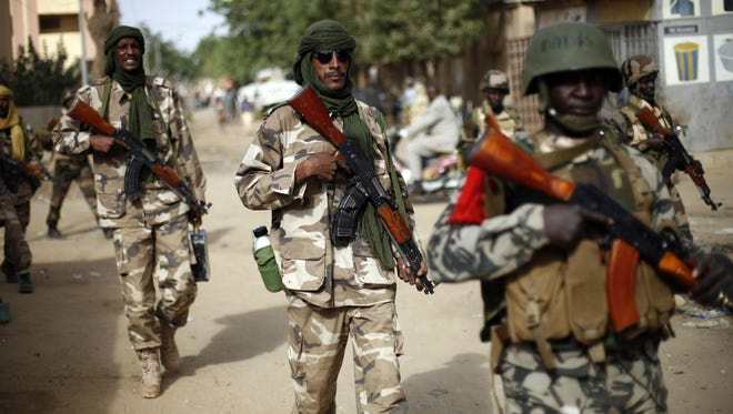 Chadian soldiers patrol the streets of Gao, northern Mali, on Jan. 29.