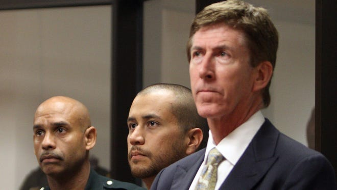George Zimmerman, center, stands with his attorney Mark O'Mara, right, and a Seminole County Deputy during a court hearing last April.