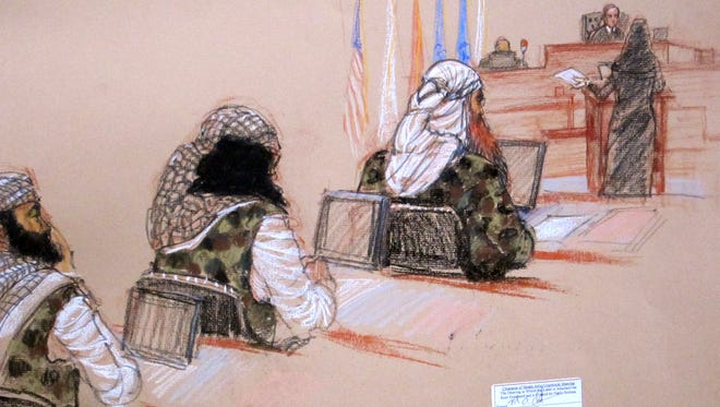 Three of the five Sept. 11 defendants attend a hearing on pretrial motions in their death penalty case at the Guantanamo Bay Naval Base in Cuba on Monday.