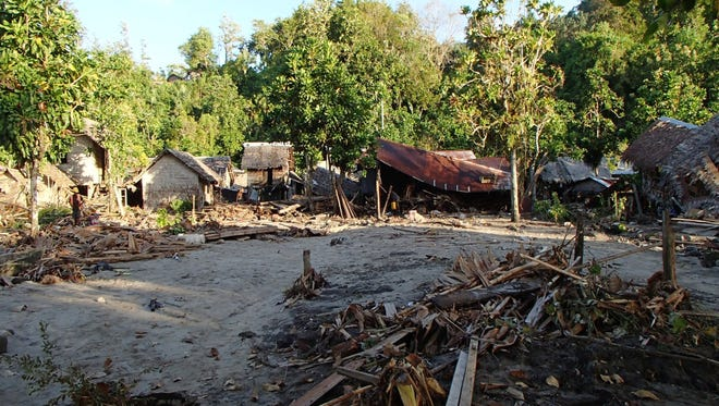 The destroyed Venga village following a tsunami on Feb. 6.