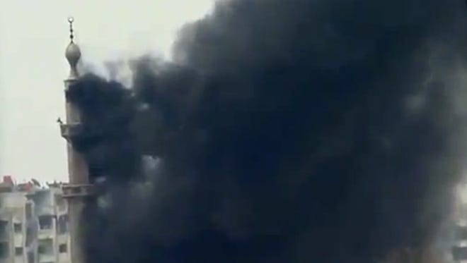 This image taken from video obtained from Ugarit News, which has been authenticated based on its contents and other AP reporting, shows smoke and fire billowing from an explosion in Damascus, Syria, on Wednesday.