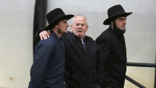 Amish men walk Friday to the Federal Courthouse in Cleveland.