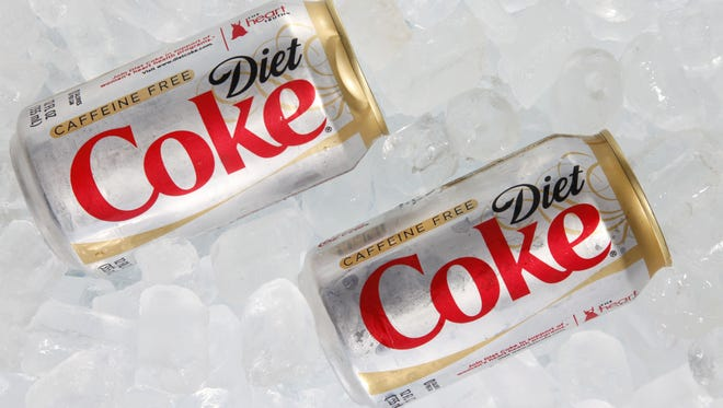 Two cans of Caffeine Free Diet Coke on ice.