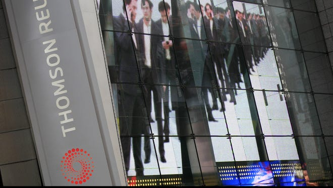 Electronic display advertising on the Thomson Reuters building in New York in this 2009 file photo.