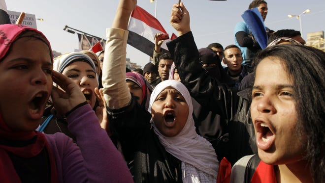 Egyptian girls chant slogans in Tahrir Square during a Jan. 25, 2012, rally to mark the one-year anniversary of the uprising that ousted President Hosni Mubarak in Cairo, Egypt.