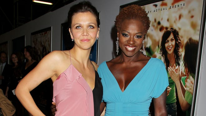 "This Sept. 23, 2012 file photo released by Starpix shows actress Maggie Gyllenhaal, left, and Viola Davis at the premiere of their film ""Won't Back Down,"" in New York"