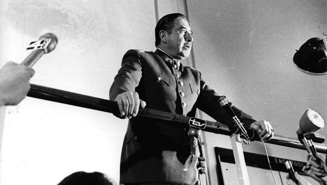 In this 1974 file photo, Chilean dictator Gen. Augusto Pinochet speaks at an informal press conference in Santiago, Chile.