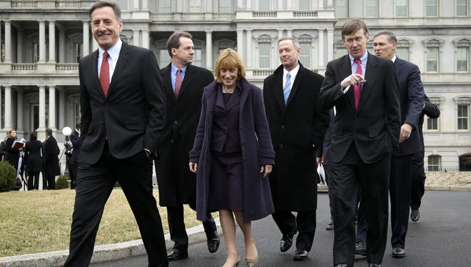 Vermont Gov. Peter Shumlin, left, leads fellow Democratic Governors Associations members along the driveway of the West Wing of the White House on Friday, following their meeting with President Barack Obama and Vice President Joe Biden. From left are, Shumlin, Montana Gov. Steve Bullock, Vermont Gov. Maggie Hassan, Maryland Gov. Martin O'Malley, Colorado Gov. John Hickenlooper, and Washington Gov. Jay Inslee.