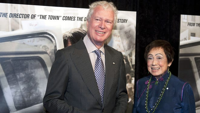 In this Wednesday, Oct. 10, 2012 file photo, former Canadian Ambassador Ken Taylor and his wife Pat, pose for photographers at the premiere of the film Argo in Washington.