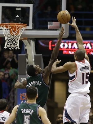 Hawks center Al Horford drops in the game-winning hook shot over Bucks center Larry Sanders during Saturday's 103-102 victory.