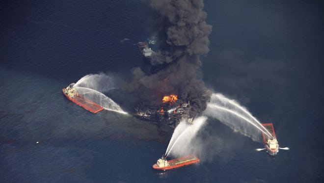 An oil slick is seen as the Deepwater Horizon oil rig burns in April 2010.