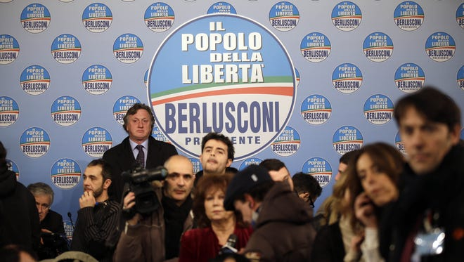 Journalists crowd the hall of the People of Freedom party headquarters as they follow first electoral result in Rome on Monday.