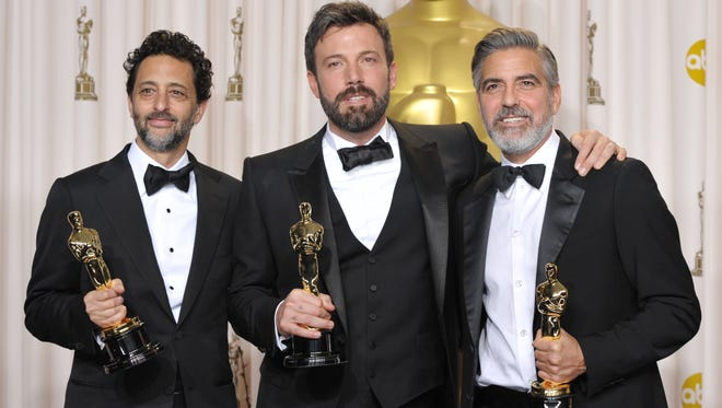 """From left: Grant Heslov, Ben Affleck, and George Clooney pose with their award for best picture for """"Argo"""" during the Oscars at the Dolby Theatre in Los Angeles on Sunday."""