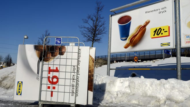 A billboard for meatballs is taken down at the Ikea store in Stockholm. Wiener's are next.