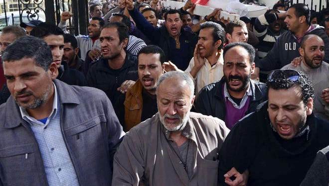 The body of Hossam Eldin Abdullah Abdelazim, who activists say died when an armored police vehicle crushed him, is carried for burial from the international hospital in Mansoura, in the Nile Delta province of Dakahliya, Egypt on Saturday.