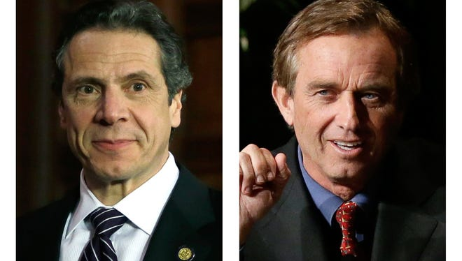 These 2013 file photos show New York Gov. Andrew Cuomo, left, in Albany, N.Y. and Robert F. Kennedy Jr. in Dallas, Texas.