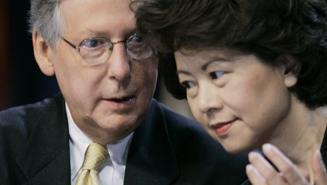 Senate Republican leader Mitch McConnell talks with his wife, then-U.S. Secretary of Labor Elaine L. Chao during the Fraternal Order of Police convention in Louisville, Ky., in 2007.