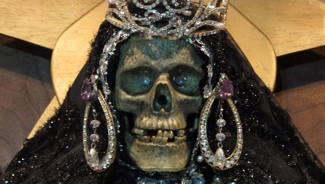 A statue of La Sante Muerte, an underworld saint most recently associated with the violent drug trade in Mexico, now is spreading throughout the U.S. among a new group of followers ranging from immigrant small-business owners to artists and gay activists.