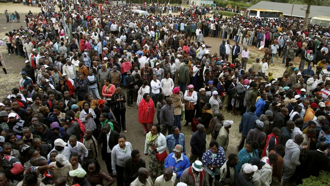 Hundreds of Kenyans lineup to cast their ballots in a general election in Nairobi on Monday.