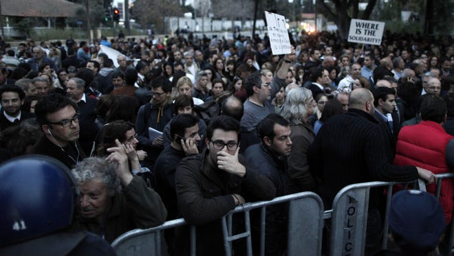 Employees of Laiki bank take part in a protest outside Cypriot parliament, Nicosia, March 21, 2013.