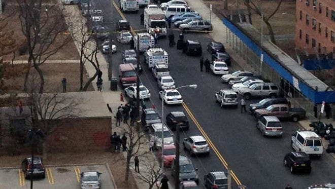 This photo provided by News 12, shows the scene near the Gravesend Houses in Coney Island, New York on Friday.