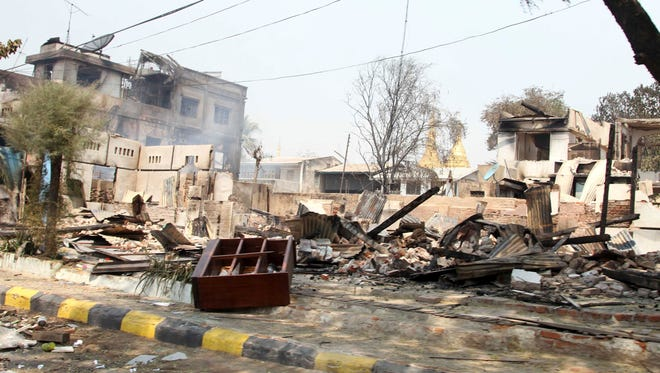 Buildings were destroyed during ethnic unrest between Buddhists and Muslims in Meikhtila, Myanmar, on Friday.