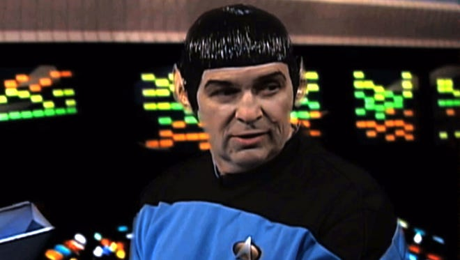 """This video image from an Internal Revenue Service video shows an IRS employee portraying Mr. Spock a scene from a video parodying the TV show """"Star Trek"""" that was made for a 2010 IRS training and leadership conference."""
