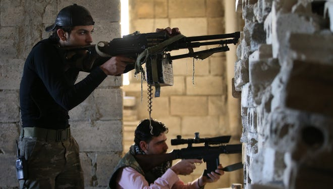 Free Syrian Army fighters take their positions earlier this year.