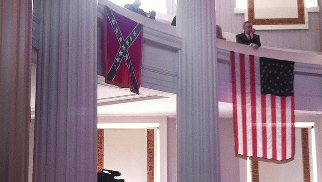 A Confederate flag is seen on display at the old Capitol, which houses the governor's office and still hosts numerous government events, Thursday.
