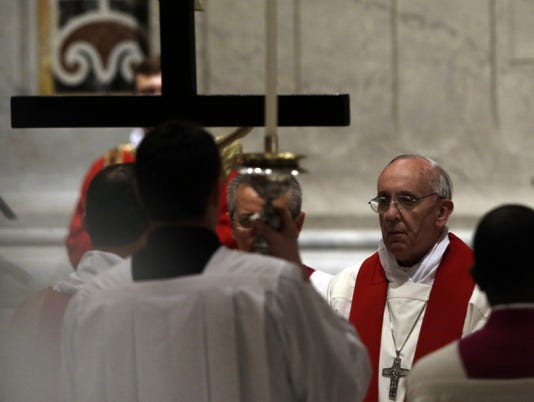 Pope's foot-wash a final straw for traditionalists
