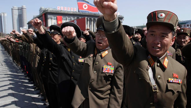 North Korean army officers punch the air as they chant slogans during a rally at Kim Il Sung Square in downtown Pyongyang, North Korea, on Friday.