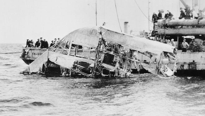 In this April 23, 1933, photograph, the wreckage of the naval dirigible USS Akron is brought to the surface of the ocean off the coast of New Jersey.
