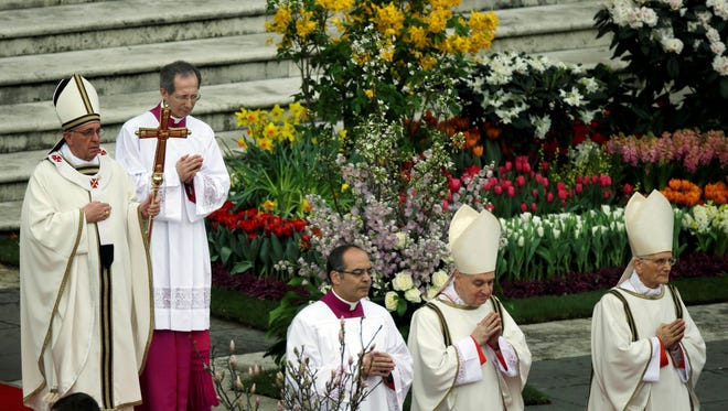 Pope Francis celebrates Easter Mass in St. Peter's Square at the Vatican.