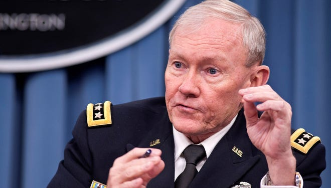 Joint Chiefs Chairman Gen. Martin Dempsey takes part in news conference at the Pentagon in Washington.