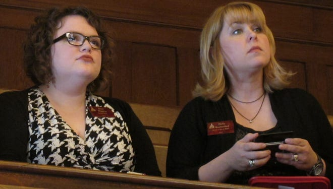 Kansas abortion-rights lobbyists Elise Higgins, left, and Holly Weatherford, watch the Senate's debate on anti-abortion legislation from the gallery on April 5.