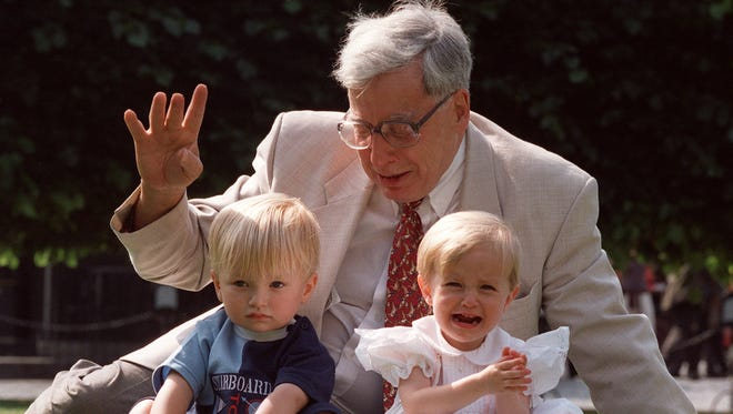 Robert Edwards, the British pioneer of IVF treatment, sits with Jack and Sophie Emery, two of his in vitro babies, in 1998 in London.