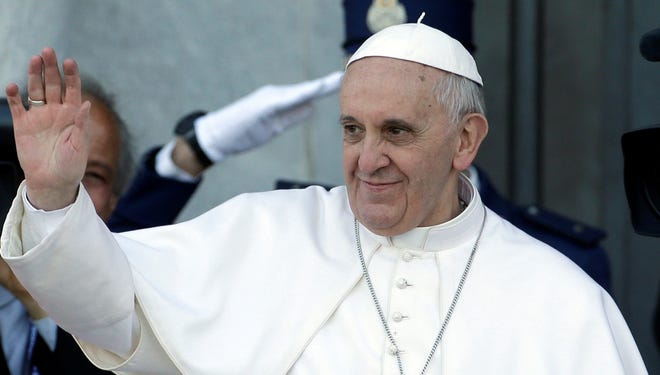 Pope Francis waves to faithful at the St. John in Lateran Basilica in Rome in April.