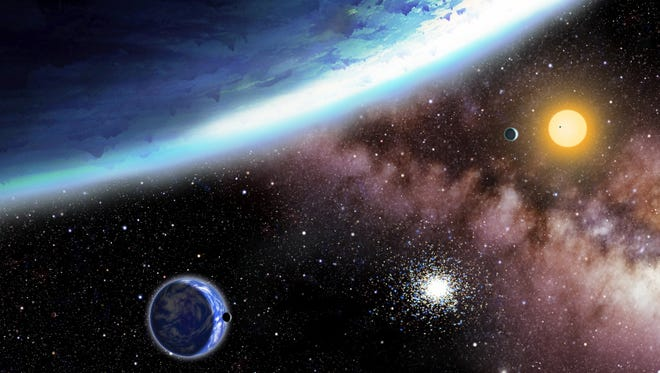 This artist's concept shows newly discovered planets named Kepler-62e and -f. Scientists using NASA's Kepler telescope have found distant planets that are in the right place and are the right size for potential life.