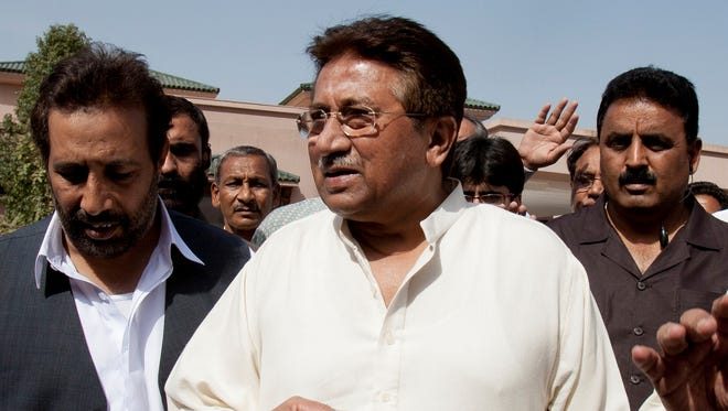 Pakistan's former President and military ruler Pervez Musharraf arrives under tight security to address his party supporters at his house in Islamabad, Pakistan.