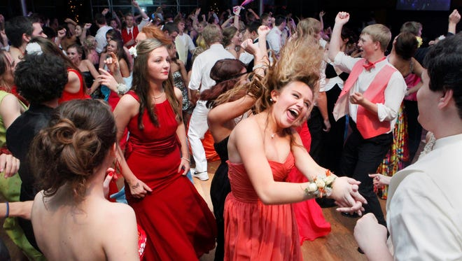 Rockford High School students dance at The Pinnacle Center during their prom in Hudsonville, Mich.