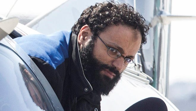 Chiheb Esseghaier, one of two suspects accused of plotting with al-Qaeda in Iran to derail a train in Canada, arrives at Buttonville Airport just north of Toronto, on April 23, 2013.