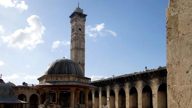 This March 6, 2013, citizen journalism image provided by Aleppo Media Center, which has been authenticated based on its contents and other AP reporting, shows the minaret of a famed 12th century Umayyad mosque before it was destroyed by the shelling, in the northern city of Aleppo, Syria. The minaret of a famed 12th century Sunni mosque in the northern Syrian city of Aleppo was destroyed Wednesday, April 24, 2013.