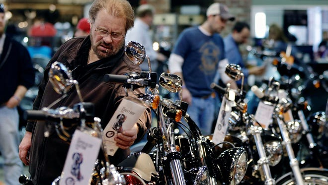 A man examines the tag on a motorcycle at  Dillon Brothers Harley Davidson in Omaha in March.