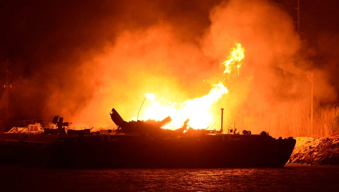 Three people were injured in explosions on a fuel barge in Mobile, Ala.