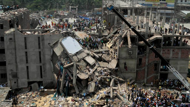 Bangladesh rescuers look for survivors and victims Thursday at the site of a building that collapsed near Dhaka, Bangladesh.