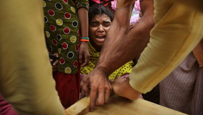 A Bangladeshi relative of garment worker Mohammed Abdullah cries as his coffin is nailed shut Saturday. Abdullah was killed in a building collapse Wednesday in Savar.