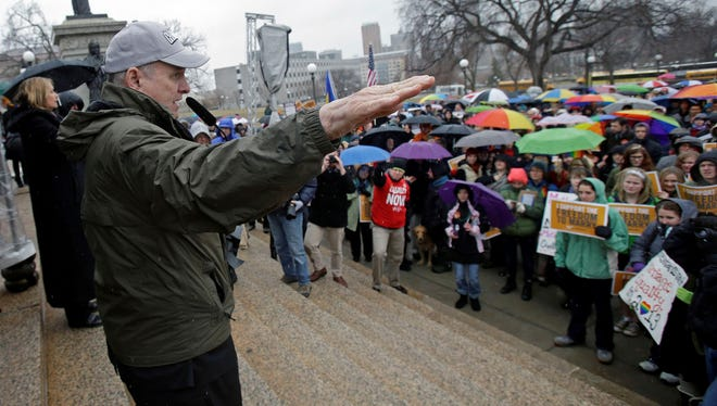 Minnesota Gov. Mark Dayton talks to hundreds who turned out to rally at the State Capitol, in St. Paul, Minn., in support of a bill to legalize gay marriage that he hopes legislators will pass this year.