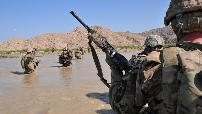 U.S. soldiers cross the Tarnak river in the Panjwai district of Kandahar province, Afghanistan, on April 10.